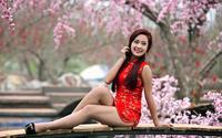 Азиатская дама в красном