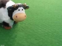 Игрушечная фигурка коровки