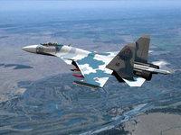 Истребитель Су-27, сверхзвуковой самолёт в полёте