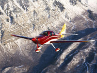 Частный самолёт в полёте среди скал
