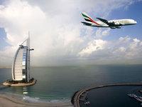 Самолёт в Эмиратах над Бурдж аль араб в Дубаи