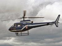 Вертолет в серых тучах