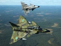 Манёвр двух военных самолётов над лесами