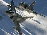 Два военных самолёта над снежными вершинами