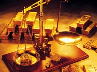 Весы и слитки золота