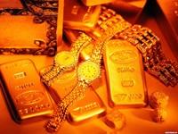 Золотые часы с золотыми слитками