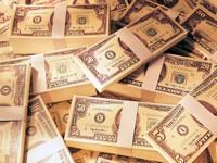 Доллары США в пачках