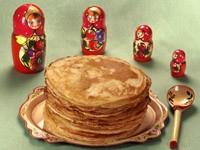 Блины на тарелке и четыре матрешки